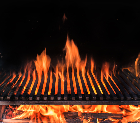 Empty grill grate and tongues of fire flame.