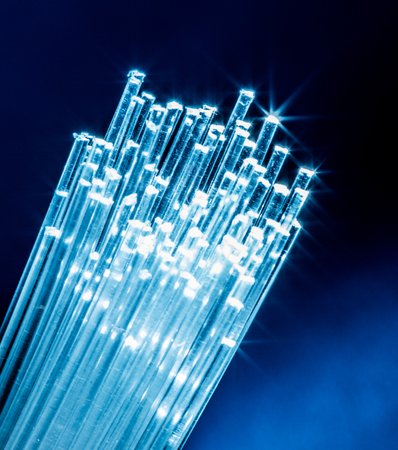 Bundle of optical fibers with lights in the ends.