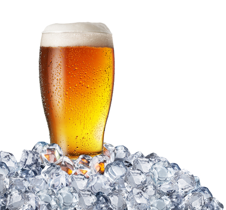Chilled glass of light beer in ice cubes. Stock fotó