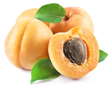 Ripe apricots isolated on the white background.