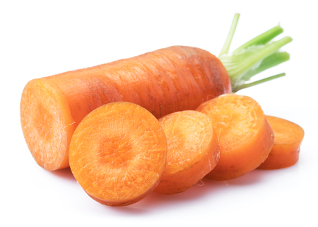 Fresh organic carrots and carrot slices on white background. Stock fotó