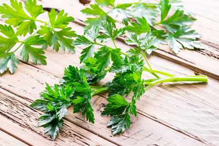 Parsley herb on the wooden background. Banco de Imagens - 122746617