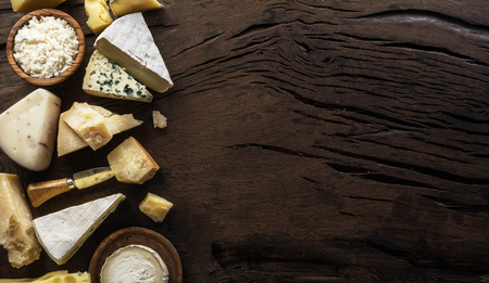 Assortment of different cheese types on wooden
