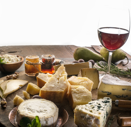 Cheese platter with organic cheeses, fruits, nuts and wine. 写真素材 - 123620456