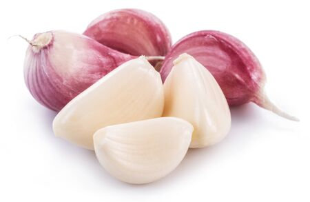 Garlic cloves on white