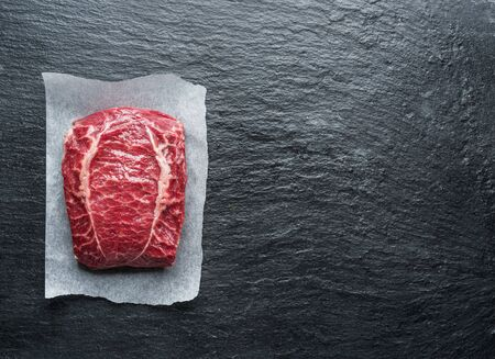The top blade steak or beef steak on the graphite board.
