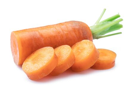 Fresh organic carrots and carrot slices on white background. Stockfoto