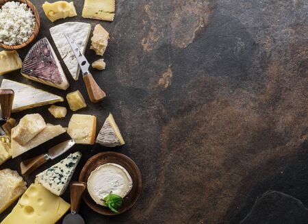Assortment of organic cheeses on stone background. Top view. Tasty cheese starter. 写真素材 - 130967551