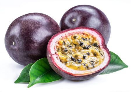 Passion fruits and its cross section with pulpy juice filled with seeds. White background.