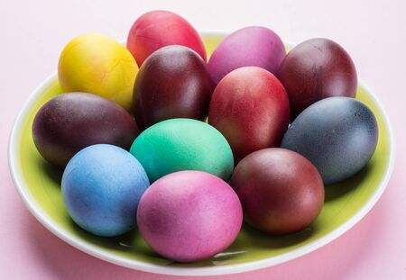 Colorful Easter eggs as an attribute of Easter celebration. Pink background. Stock fotó