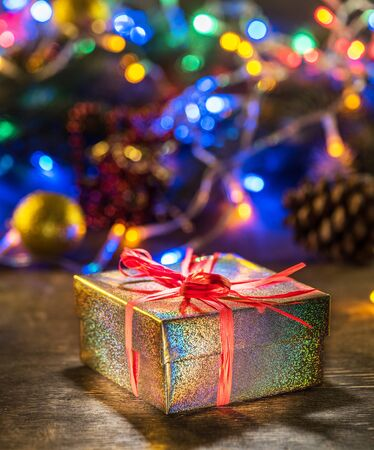 Beautiful Christmas gifts in decorated boxes near a Christmas tree in the home.