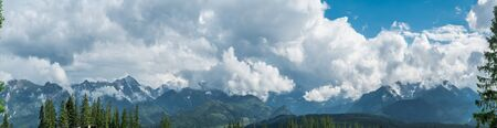 Landscape of High Tatras in the spring. Snowy mountain tops and beautiful sky. Banco de Imagens