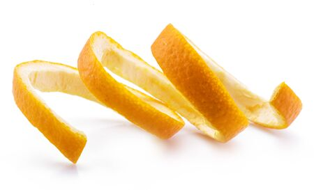Orange peel or orange twist on white background. Close-up.
