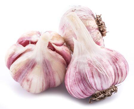 Three garlic bulbs isolated on white background.