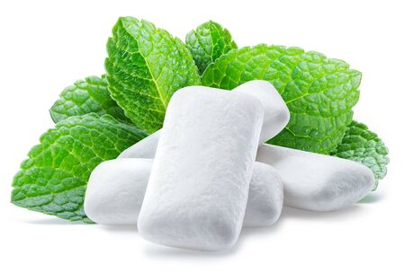 Chewing gum pads with mint leaves isolated on white background.