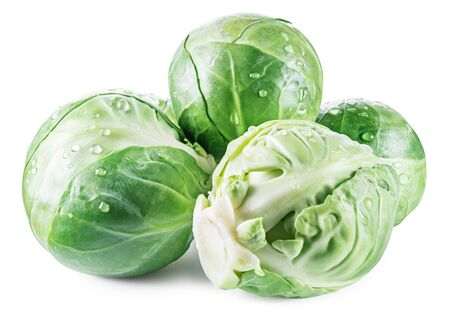 Green brussel sprouts with water drops isolated on white background.