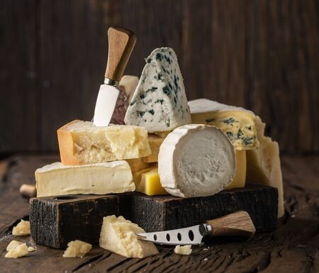Assortment of different cheese types on wooden background. Cheese background. Stok Fotoğraf