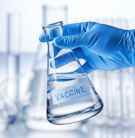 In the laboratory in a glass flask is a vaccine against the virus.