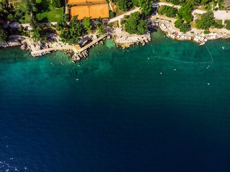 Beautiful panoramic view of Lovran village and its sea shore in Croatia. Top view photo taken on drone.