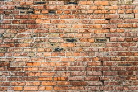 Old red brick wall.  Close-up picture of bricks. Stock fotó
