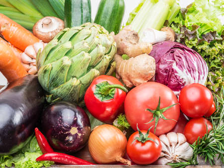 Fresh multi-colored vegetables in wooden crate. Top view. Standard-Bild