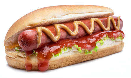 Hot dog - grilled sausage in a bun with sauces isolated on white background. Standard-Bild