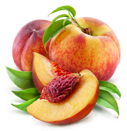 Peaches with leaves and peach slices isolated on a white background. Clipping path.