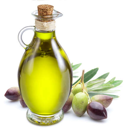 Ripe natural olives with bottle of olive oil isolated on a white background.