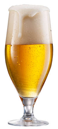 Glass of pale lager beer with a large head of beer foam