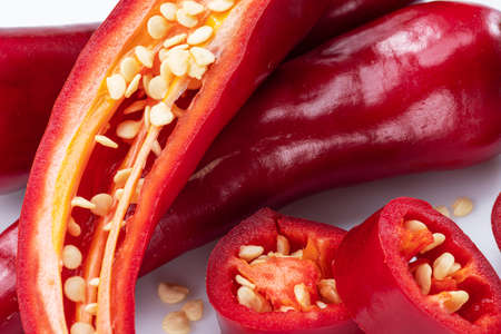 Fresh red chili peppers and cross section of chili pepper with seeds