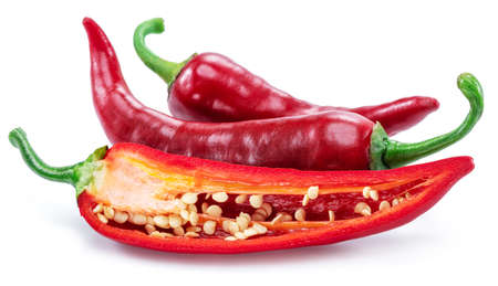 Fresh red chili pepper and cross section of chili pepper with seeds Фото со стока