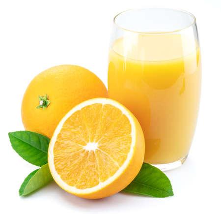 Yellow orange fruits and glass of fresh orange juice Фото со стока