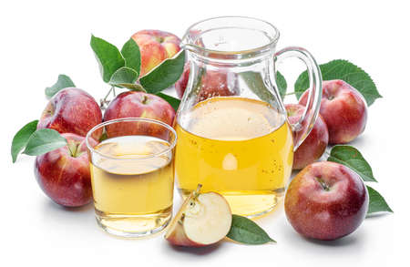 Glass and carafe of fresh apple juice and organic apples isolated on white background.