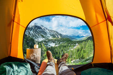 Spectacular view of nature from open tent entrance. The beauty of romantic trekking and camping.