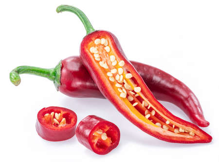 Fresh red chilli pepper and cross sections of chilli pepper with seeds isolated on white background. Фото со стока