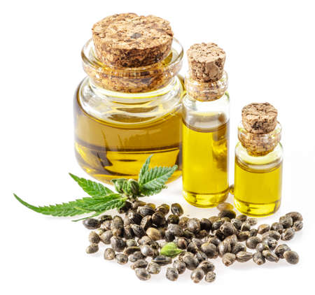 Cannabis seeds and hemp oil isolated on white background. Close up.