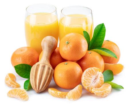 Orange tangerine fruits and two glasses of fresh tangerine juice isolated on white background. Фото со стока