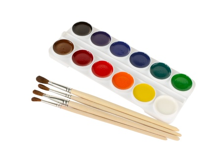 Watercolor paints and paintbrushes on a white background