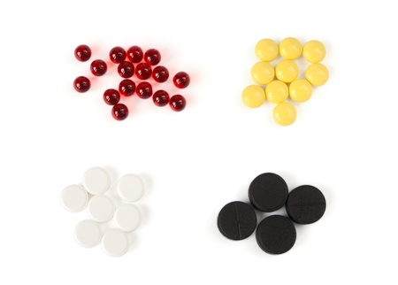Colored pills on a white background Stock Photo - 16358672