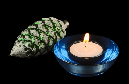 Circular candle and christmas-tree decoration on a black background Stock Photo - 16358708