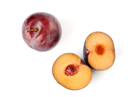 Three plums on a white background photo
