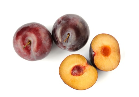 Four plums on a white background Stock Photo - 16560782