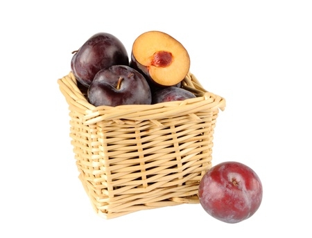 Plums in a small basket on a white background Stock Photo - 16560781
