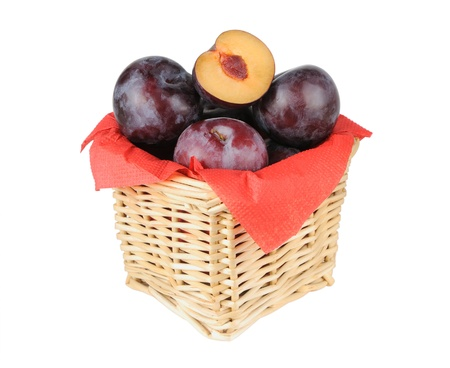 Plums in a small basket on a white background Stock Photo - 16560783