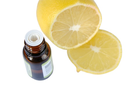 Essential oil bottles and lemon on a white background photo