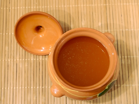 Melted butter in a clay pot