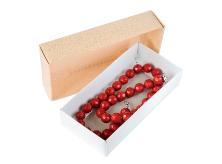 Coral necklace in a paper box isolated on white Stock Photo - 17090952