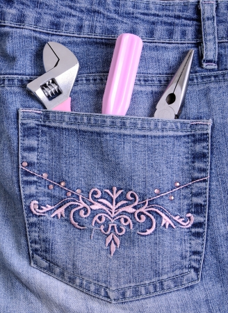 Pink working tools in a pocket of female jeans Stock Photo