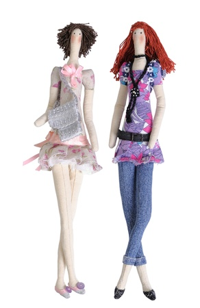 Two tilda dolls isolated on white