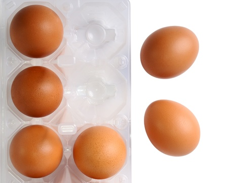 Eggs in packing closeup isolated on the white